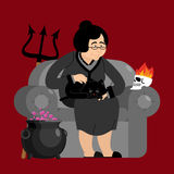 Witch in chair. Skull and black cat. Sorceress and Magic Pot Pot Stock Image