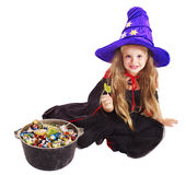 Witch child with candy. Stock Photo