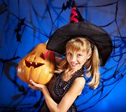 Witch child at Halloween party. Happy witch child at Halloween party Royalty Free Stock Image