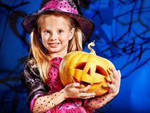 Witch child at Halloween party. Happy witch child at Halloween party Royalty Free Stock Photo