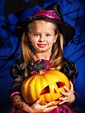 Witch child at Halloween party. Happy witch child at Halloween party Stock Photo