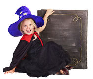 Witch child holding  book. Stock Photo