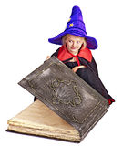 Witch child holding  book. Stock Photography