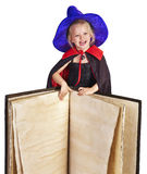 Witch child holding  book. Royalty Free Stock Image