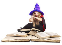 Witch child holding  book. Stock Photos