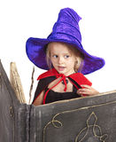 Witch child holding  book. Stock Images