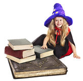 Witch child with stack book. Stock Images