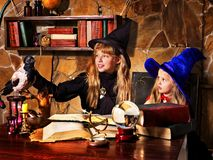 Witch  children with crystal ball. Royalty Free Stock Image