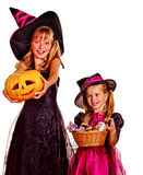 Witch children in hat into Halloween party. Royalty Free Stock Photo