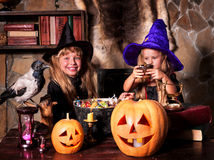Witch  children with pumpkin lantern Royalty Free Stock Image