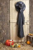 Witch clothes a barn door, pumpkins Royalty Free Stock Image