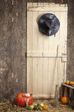 Witch clothes a barn door, pumpkins Royalty Free Stock Photo