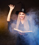 Witch conjuring Stock Images
