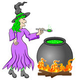 Witch cooking a magic potion in the cauldron Stock Images