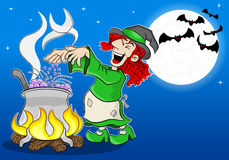Witch cooking a magic potion in the cauldron Royalty Free Stock Images