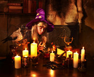 Witch  with crystal ball. Royalty Free Stock Images