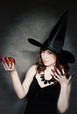 Witch with crystal ball in hand Stock Photo