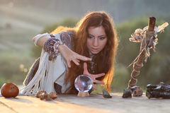 Witch with crystal ball at sunset Stock Image