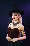 Witch on a dark background Royalty Free Stock Photography