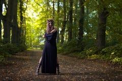 Witch in dark forest Stock Photo