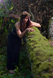 Witch in dark forest Stock Images
