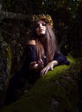 Witch in dark forest Royalty Free Stock Photography