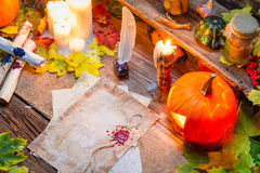 Witch desk full of scrolls and candles Royalty Free Stock Photos