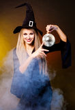 Witch with a disco ball Stock Image