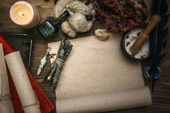 Witch doctor. Shaman. Witchcraft. Magic table. Alternative medicine. Ancient magic scroll paper sheet with copy space. Witchcraft. Witch doctor desk table Royalty Free Stock Image