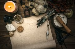 Witch doctor. Shaman. Witchcraft. Magic table. Alternative medicine. Ancient magic scroll paper sheet with copy space. Witchcraft. Witch doctor desk table Stock Image