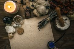Witch doctor. Shaman. Witchcraft. Magic table. Alternative medicine. Ancient magic scroll paper sheet with copy space. Witchcraft. Witch doctor desk table Stock Photography