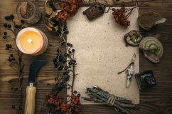 Witch doctor. Shaman. Witchcraft. Magic table. Alternative medicine. Ancient magic scroll paper sheet with copy space. Witchcraft. Witch doctor desk table Stock Photo