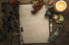 Witch doctor. Shaman. Witchcraft. Magic table. Alternative medicine. Ancient magic scroll paper sheet with copy space. Witchcraft. Witch doctor desk table Royalty Free Stock Photos