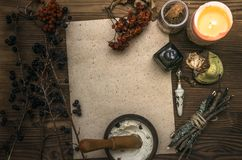 Witch doctor. Shaman. Witchcraft. Magic table. Alternative medicine. Ancient magic scroll paper sheet with copy space. Witchcraft. Witch doctor desk table Royalty Free Stock Images