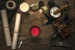 Witch doctor. Shaman. Witchcraft. Magic table. Alternative medicine. Ancient magic scroll on wooden desk table. Witchcraft. Witch doctor desk table. Magic Stock Image