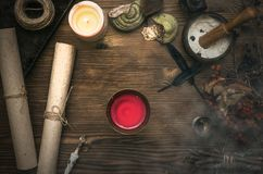 Witch doctor. Shaman. Witchcraft. Magic table. Alternative medicine. Ancient magic scroll on wooden desk table. Witchcraft. Witch doctor desk table. Magic Stock Photos
