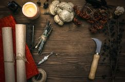 Witch doctor. Shaman. Witchcraft. Magic table. Alternative medicine. Ancient magic scroll on wooden desk table. Witchcraft. Witch doctor desk table. Magic Royalty Free Stock Photography