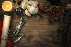 Witch doctor. Shaman. Witchcraft. Magic table. Alternative medicine. Ancient magic scroll on wooden desk table. Witchcraft. Witch doctor desk table. Magic Royalty Free Stock Photos
