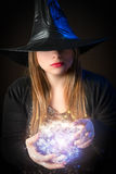 Witch does magic. Blond witch does magic with his hands Stock Image