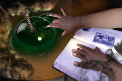 Witch doing magic. She is producing a giraqffe out of a green bubble, and that is something Stock Photo