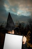 Witch with empty banner Royalty Free Stock Photo