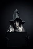 Witch with empty banner Royalty Free Stock Photography