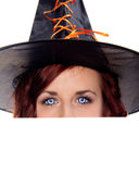 Witch Eyes. Pretty Witch with blue zombie eyes Stock Photo