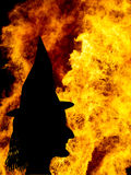 Witch face silhouette over fames, bonfire. Halloween etc. Stock Photography