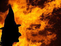 Witch face silhouette over flames, bonfire. Halloween etc. Royalty Free Stock Photography