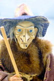 Witch figurine mounted on her broom. Royalty Free Stock Photo
