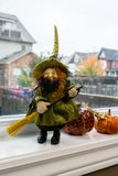 A witch figurine and two pumpkins Royalty Free Stock Photos
