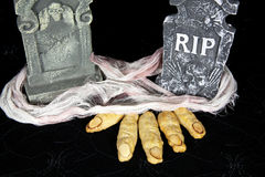 Witch Fingers in Grave. Cheesy witches fingers digging out of grave with headstones Royalty Free Stock Image