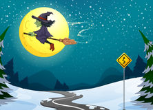 A witch floating with her broomstick Stock Image