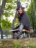 Witch fly on broomstick outdoor. Royalty Free Stock Photos